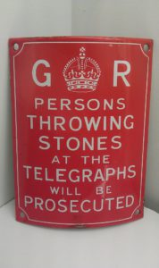 Persons_throwing_stones_at_the_telegraphs_-_sign